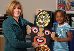 ART, little girl with totem pole