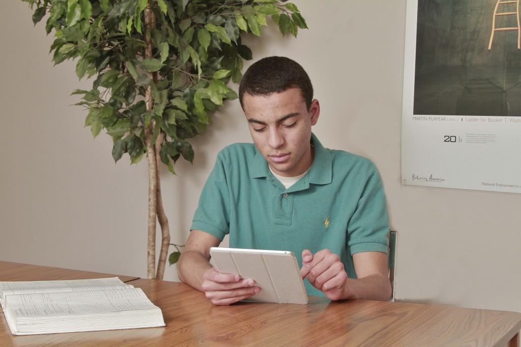 2015, teen boy holding iPad